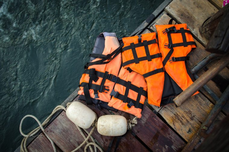orange life vest on wooden background
