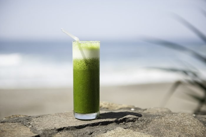 Healthy drink on the beach, ocean in the background