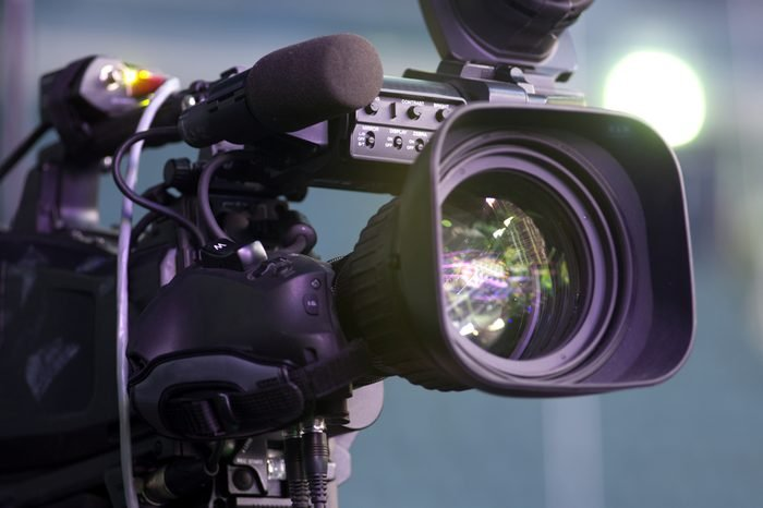 Professional digital video camera. accessories for 4k video cameras.tv camera in a concert hall.