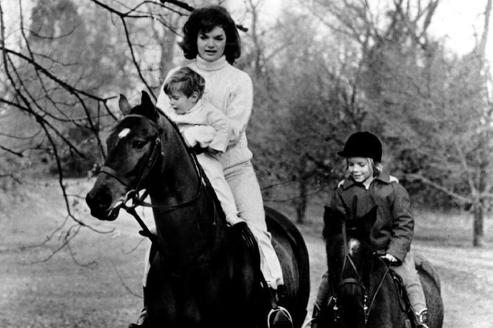 First Lady Jacqueline Kennedy and her children John F. Kennedy Jr. and Caroline Kennedy riding.