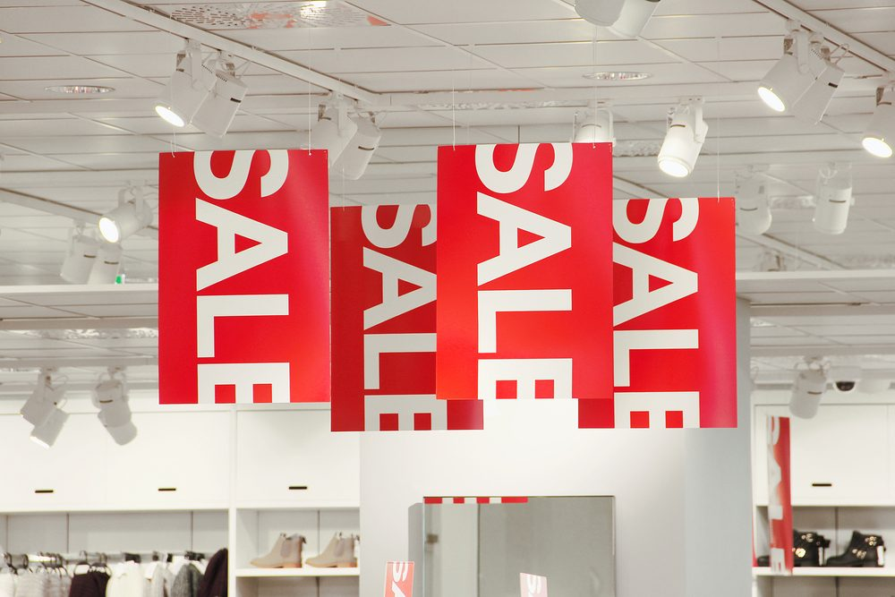 Sale signs in a clothing store.