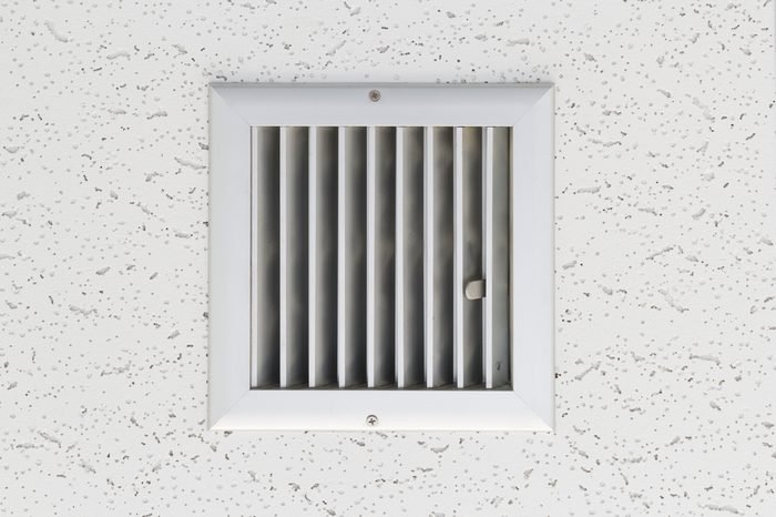 Grille of air conditioner system under ceiling.