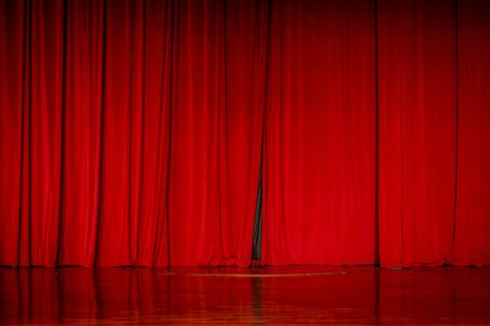 Red curtains in a theater scene of the show.