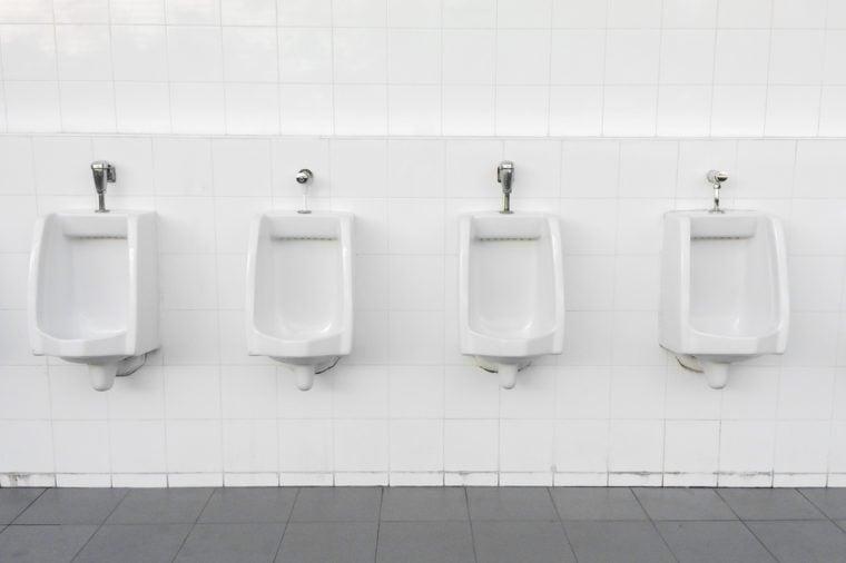 Close up row of outdoor urinals men public toilet,Closeup white urinals in men's bathroom, design of white ceramic urinals for men in toilet room.
