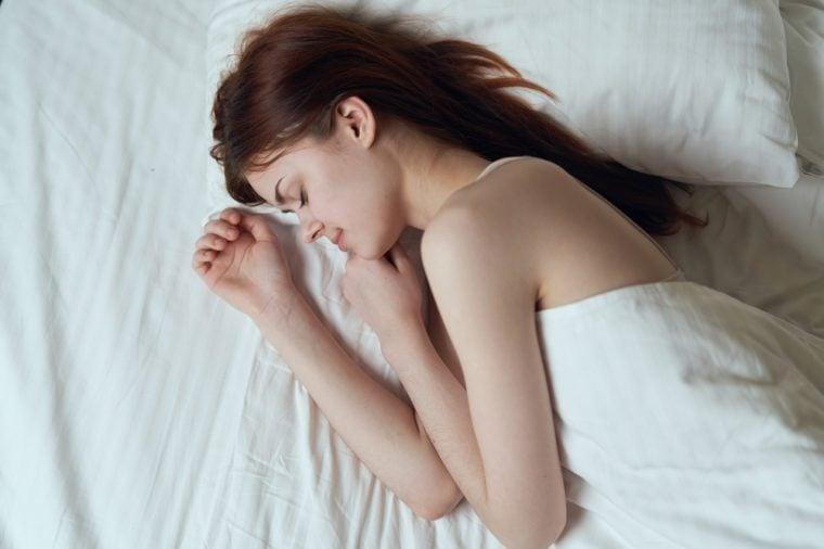 Woman sleeping, woman sleeping on the bed, young woman sleeping