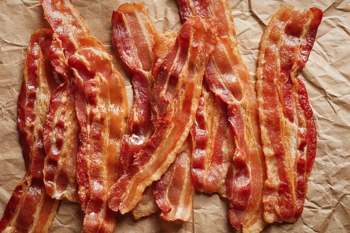 Cooked bacon rashers on parchment