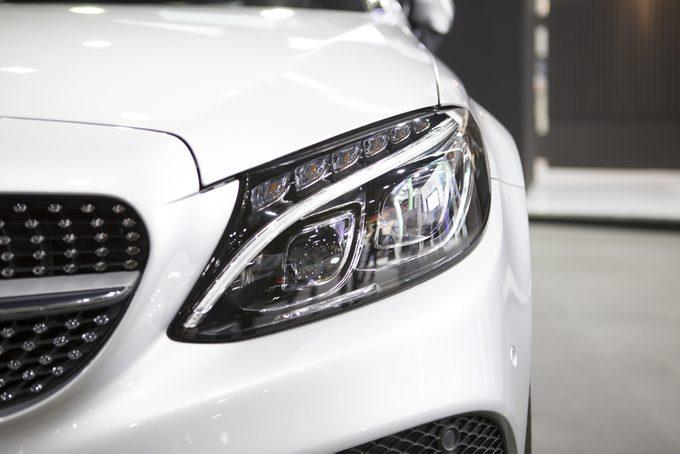 Closeup headlights of car left
