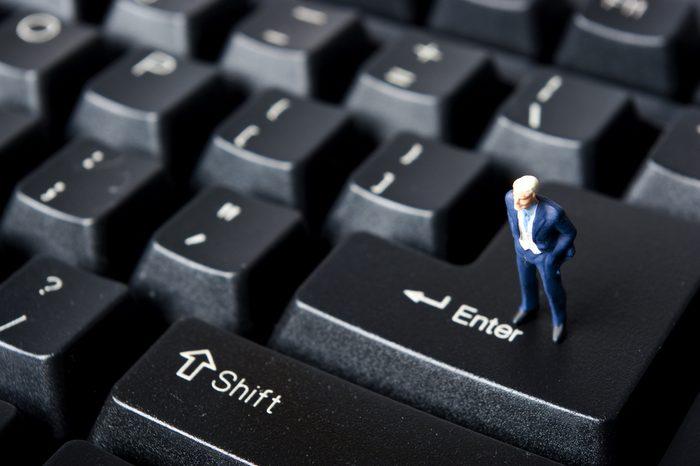 miniature man on keybord
