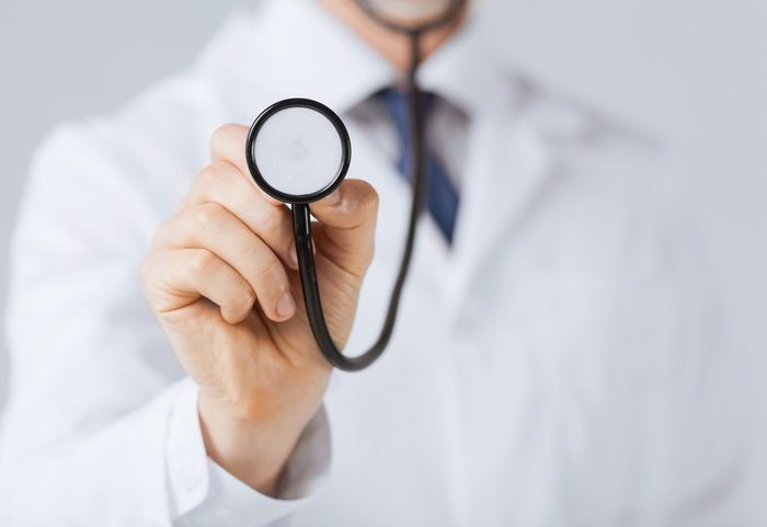 picture of doctor hand with stethoscope listening something