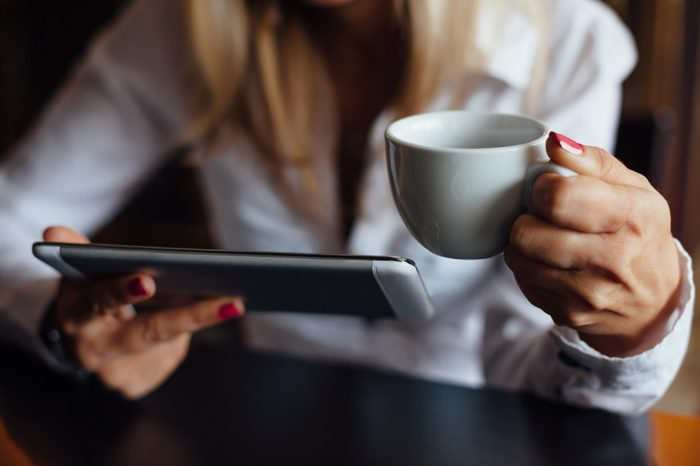 Woman using tablet in a cafe