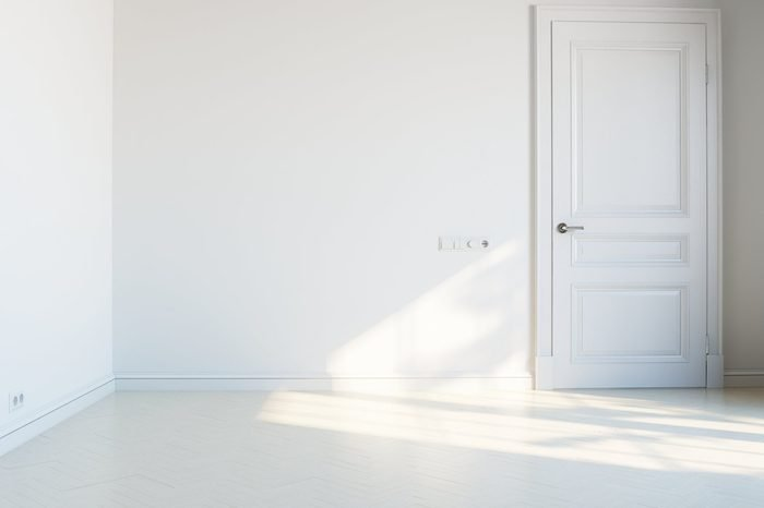 empty white interior with door