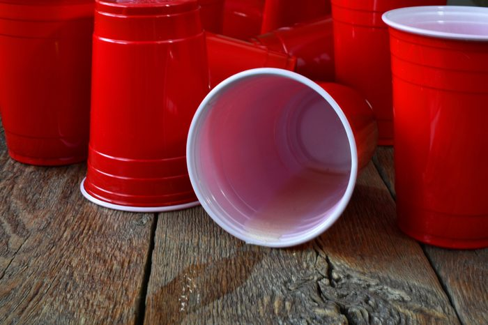 Spilled Beer Pong Cup on a Wooden Table