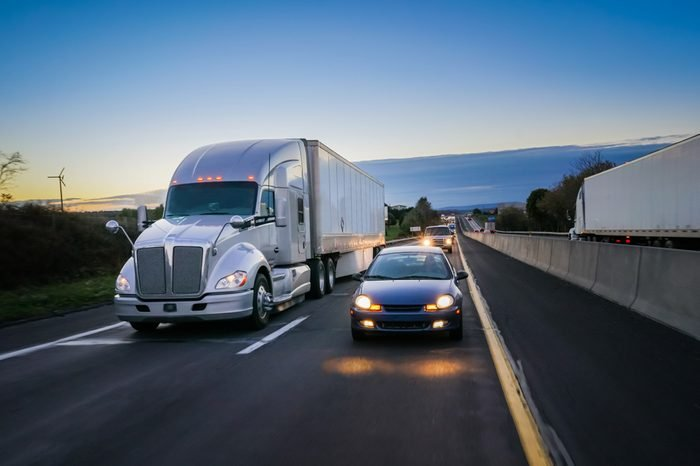 18 wheeler semi truck at night on highway