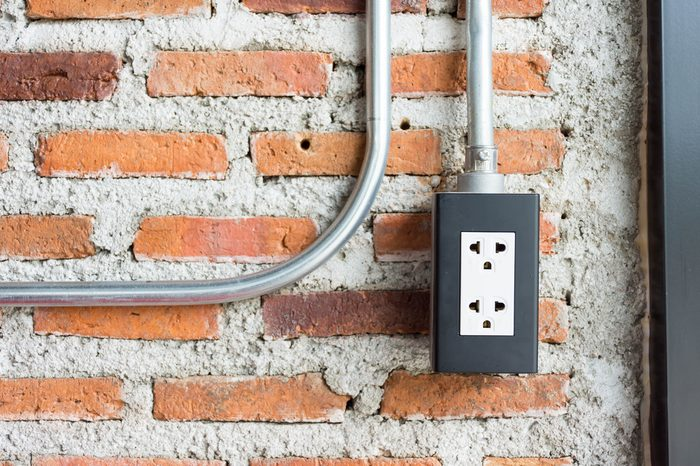 plug socket on brick wall background