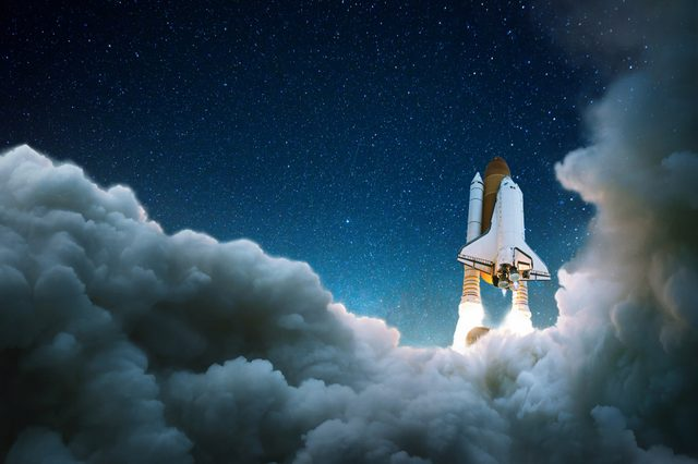 Rocket takes off in the starry sky. Spaceship begins the mission. Space shuttle taking off on a mission.