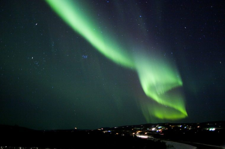 Auroral display in the shape of S letter, or US dollar