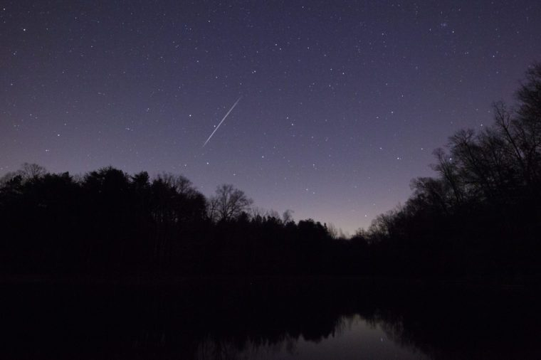 A Geminid Meteor in the night sky over Lake Norman in North Carolina