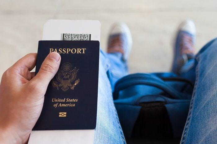 Man holding ticket and passport