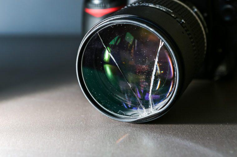 Broken DSLR camera lens filter glass