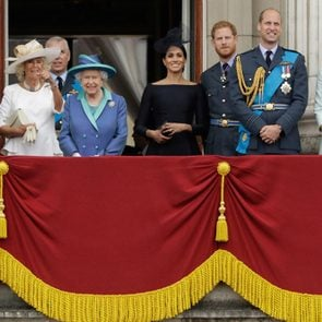 Members of the royal family gather on the balcony of Buckingham Palace, with from left, Prince Charles, Camilla the Duchess of Cornwall, Prince Andrew, Queen Elizabeth II, Meghan the Duchess of Sussex, Prince Harry, Prince William and Kate the Duchess of Cambridge, as they watch a flypast of Royal Air Force aircraft pass over Buckingham Palace in London, . Various events were held Tuesday to mark 100-years since the formation of the RAF