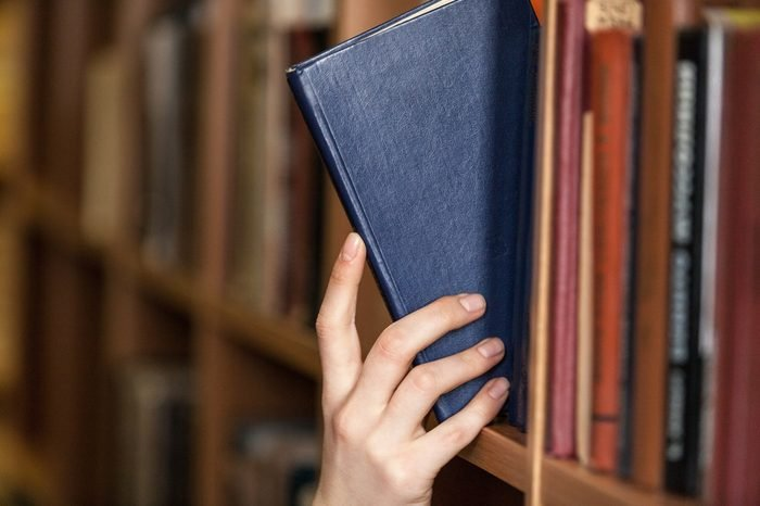 Hand holds book.