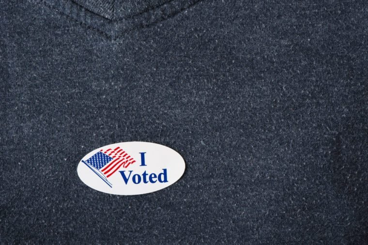 "An American ""I voted"" sticker placed on a navy shirt."