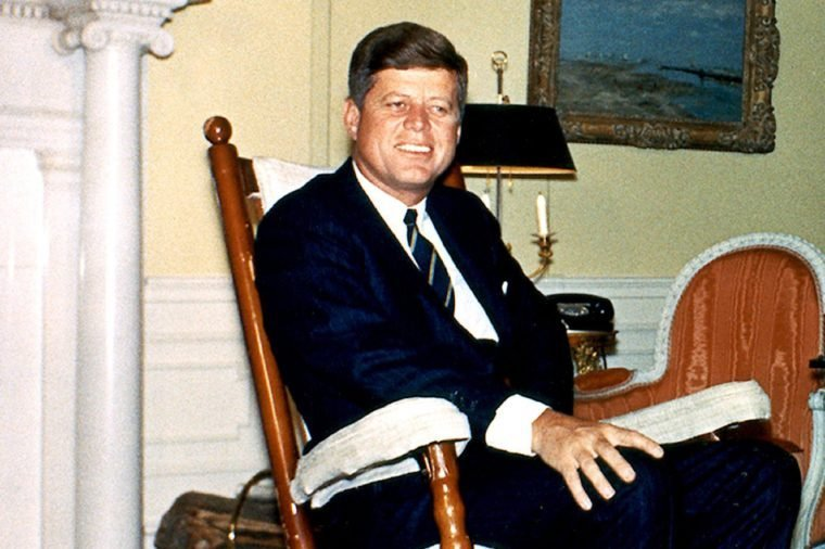United States President John F. Kennedy photographed in his rocking chair in the Yellow Oval Room of the White House in Washington, D.C. on March 19, 1962.
