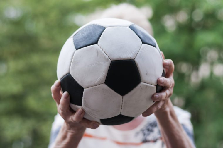 Active senior woman catches football. Close up of hands and Soccer./Senior catches Soccer