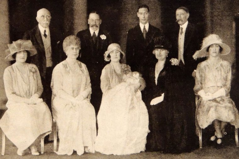 Photograph taken during the Christening of Princess Elizabeth Alexander Mary (1926- Present). Back row (L to R) Duke of Connaught, HM King George V, Duke of York, Earl of Strathmore. Front row (L to R) Lady Elphinstone, HM Queen Mary, Duchess of York and baby, Countess of Strathmore, Princess Mary, and Viscountess Lascelles. 1926