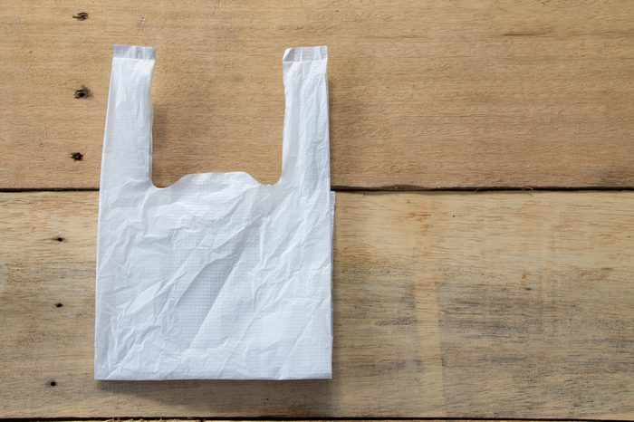 White plastic bag on the wooden background, recycle concept
