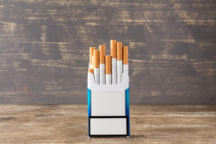 Open pack of cigarettes with cigarettes sticking out