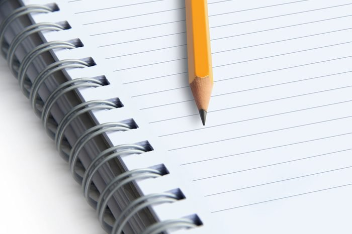 image of a notebooks and pencil on white background, close-up