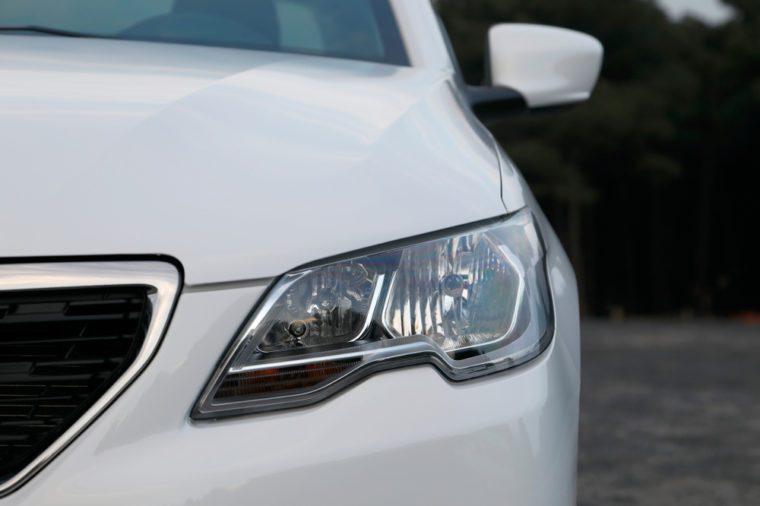 modern car headlight, car exterior detail.