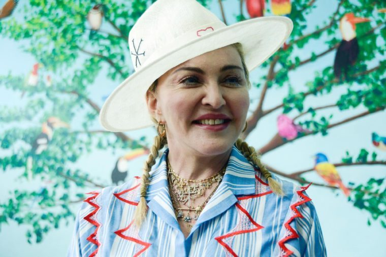 US singer Madonna speaks to the press at a news conference in Blantyre, Malawi, . Madonna has adopted four Malawian children, is in the country to celebrate the first anniversary of the Mercy James Centre for Pediatric Surgery and Intensive Care, named after one of her adopted daughters