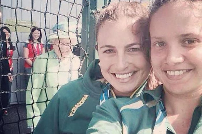 Australian hockey player Jayde Taylor has her selfie photobombed by Queen Elizabeth II at the Glasgow National Hockey Centre