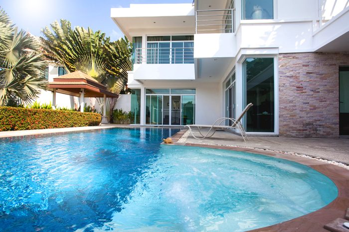 Interior and exterior design of pool villa which features living area, greenery garden, pavilion and swimming pool