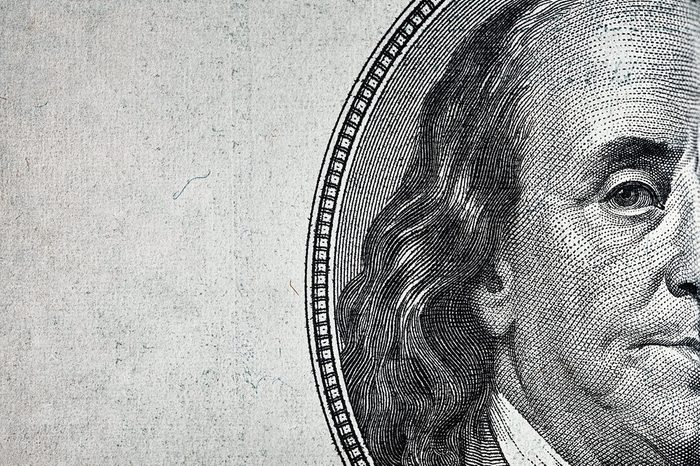 Dollars closeup. Benjamin Franklin's portrait on one hundred dollar bill.
