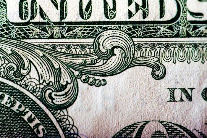 Macro photograph of a one dollar bill