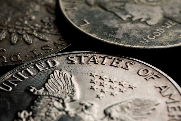 US silver dollars closeup macro shot, selective focus