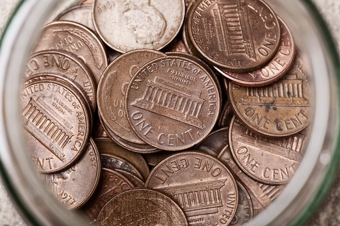 Young childs collection of Pennies in a Jar