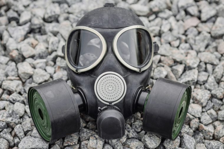 black gas mask on stone background