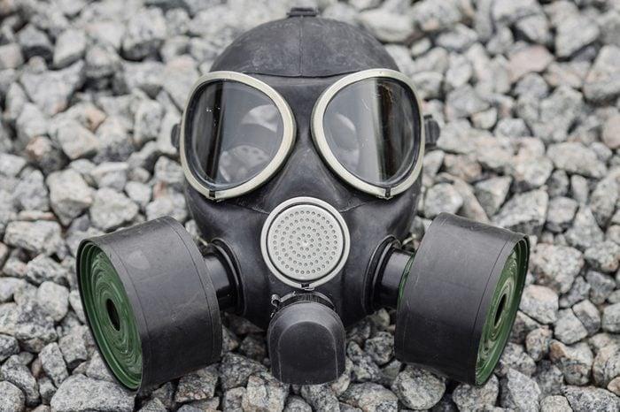 black gas mask on stone background