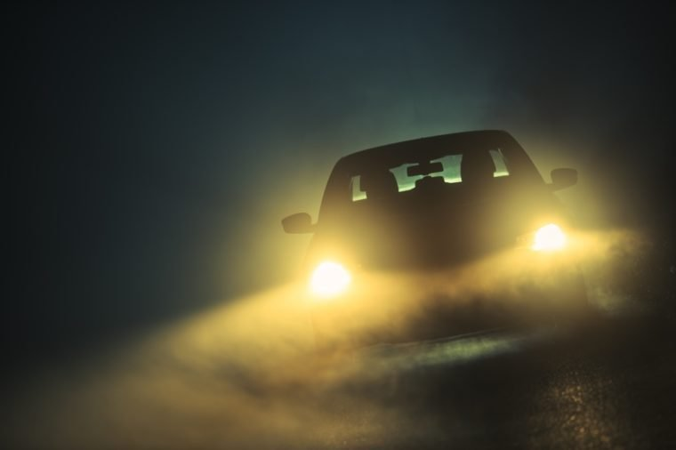 Car Driving in Dense Fog. Dangerous Road Conditions. Night Time Driving in Fog.