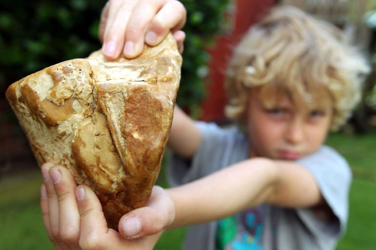 8-year-old Charlie Naysmith with the piece of ambergris