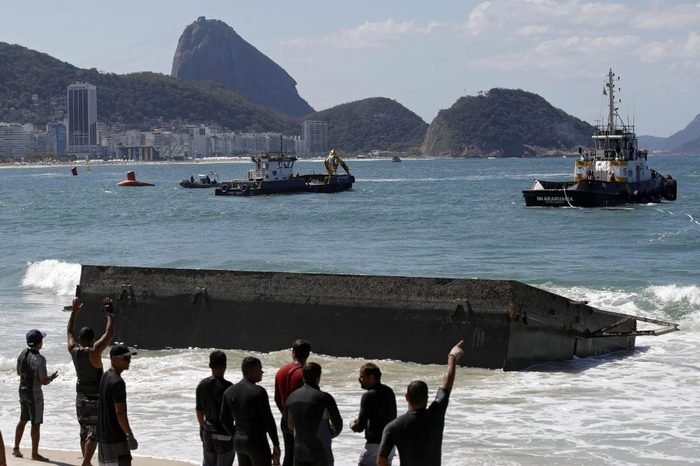 People Try to Recover a Part of the Starting Platform For the Marathon Swimming During the Rio 2016 Olympic Games at Copacabana Beach in Rio De Janeiro Brazil 13 August 2015 the Structure was Washed Up Ashore Two Days Before the Marathon Swimming Competition Starts the Trainings Had to Be Suspended Due to the Incident and the Beach Area Had to Be Closed Brazil Rio De Janeiro