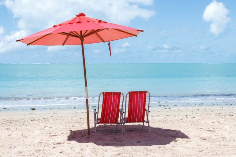 Pair of chairs and an umbrella on the beach of Ponta Verde, Maceio, Alagoas, northeast of Brazil
