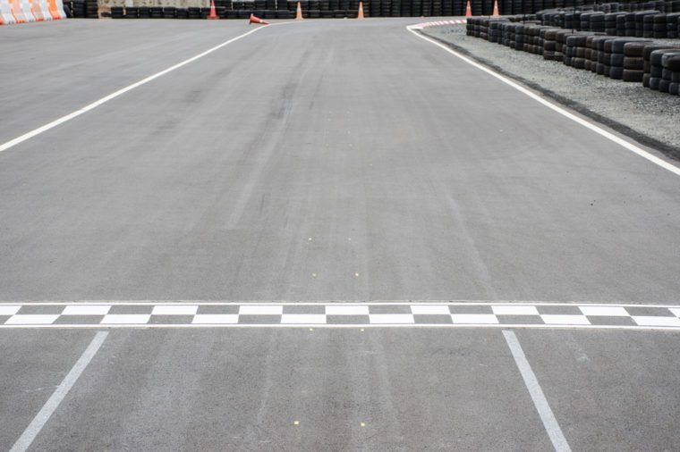 Start and Finish motor race line asphalt on Monaco Montecarlo Grand Prix street circuit