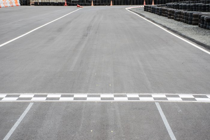 Start and Finish motor race line asphalt on Monaco Montecarlo Grand Prix street circuit