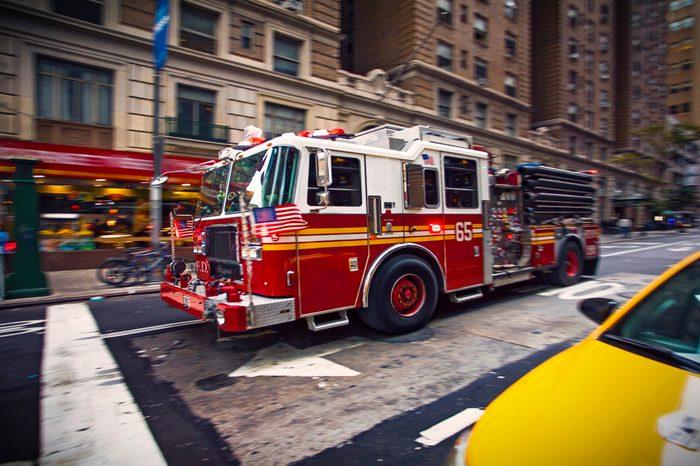 New York firefighter pumper truck responding to a emergency call in Manhattan downtown