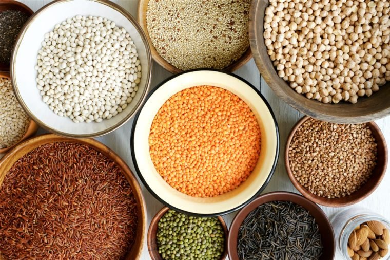 Assorted cereals and legumes. Protein products for vegans. Lentils, mung beans, quinoa, buckwheat, chia, beans, wild rice (Zizania), red rice, nuts